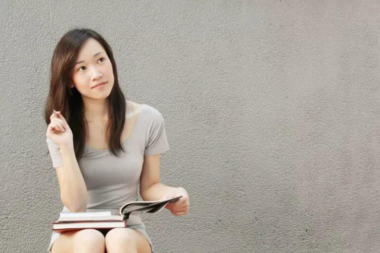 girl sitting thinking